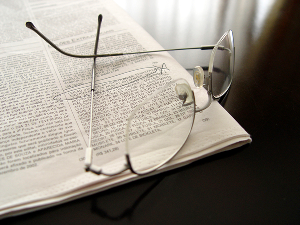 A picture of a newspaper and glasses