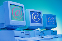 A picture of three computers displaying some technical copywriting material