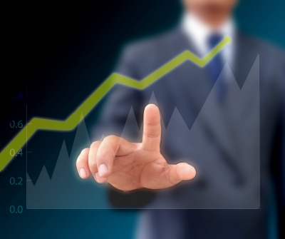 Picture of a man keen to learn about copywriting by pointing at a graph